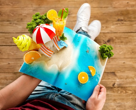 Foto per Tropical island with palms, ice cream and fresh juice on a page of opened magazine in hands. Unusual travel 3d illustration. Summer travel and vacation concept - Immagine Royalty Free