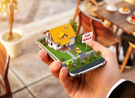 Foto de Smartphone application for online searching, buying, selling and booking real estate. Unusual 3D illustration of beautiful house on smartphone in hand - Imagen libre de derechos