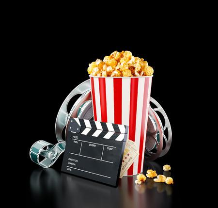 Photo pour Popcorn, cinema reel, disposable cup, clapper board and tickets at black background. Concept cinema theater 3D illustration. - image libre de droit