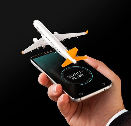 Foto de Smartphone application for online searching, buying and booking flights on the internet. Unusual 3D illustration of commercial airplane on smartphone in hand - Imagen libre de derechos