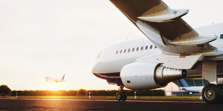 Foto de White commercial airplane standing on the airport runway at sunset. Passenger airplane taking off. Airplane concept 3D illustration. - Imagen libre de derechos