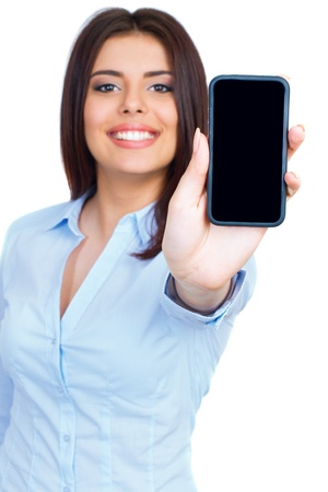 Photo for Young woman showing display of mobile cell phone with black screen and smiling on a white background. Focus on hand. - Royalty Free Image