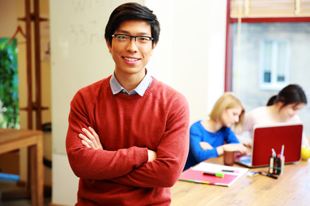 Foto für Happy young asian student in classroom - Lizenzfreies Bild