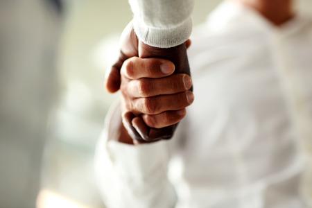 Close-up of businessmen shaking hands