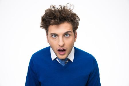 Foto de Surprised young man looking at the camera over white background - Imagen libre de derechos