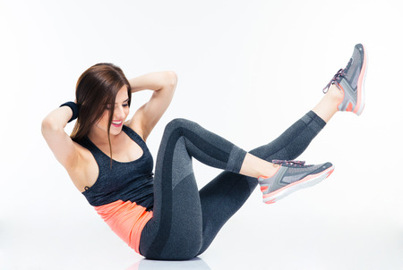 Photo pour Smiling fitness woman doing abdominal exercises isolated on a white background - image libre de droit