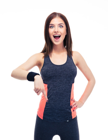 Photo for Surprised fitness woman pointing finger down isolated on a white background. Looking at camera - Royalty Free Image