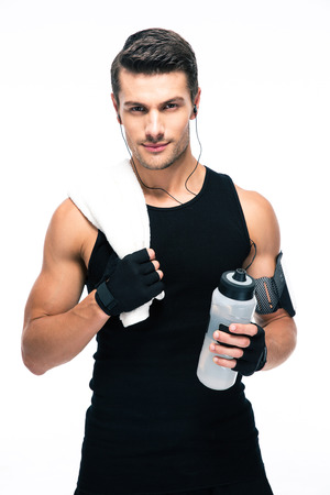 Photo for Handsome fitness man holding towel and bottle with water isolated on a white background. Looking at camera - Royalty Free Image