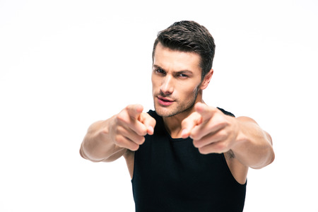 Photo pour Fitness man pointing fingers at camera isolated on a white background - image libre de droit