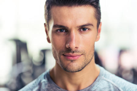 Photo pour Closeup portrait of a handsome man at gym - image libre de droit