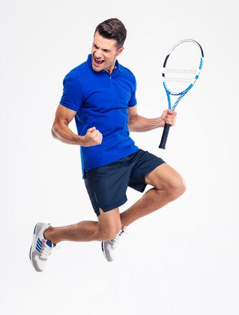 Photo pour Portrait of a handsome male tennis player celebrating his success isolated on a white background - image libre de droit