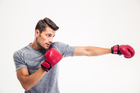 Foto de Side view portrait of a handsome man boxing isolated on a white background - Imagen libre de derechos