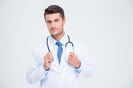 Photo pour Portrait of a male doctor standing with stethoscope isolated on a white background - image libre de droit