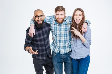Photo for Group of happy three friends in casual wear standing and laughing - Royalty Free Image