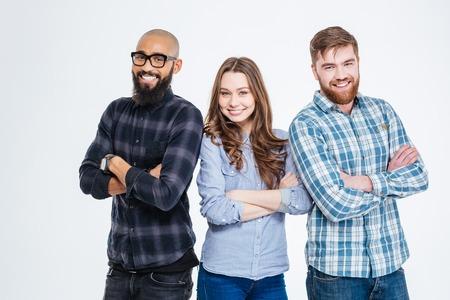 Photo pour Multiethnic group of three confident smiling students standing - image libre de droit