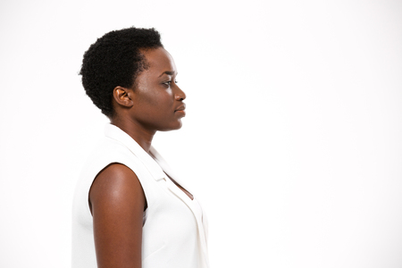 Photo for Profile of beautiful serious african american young woman with short haircut over white background - Royalty Free Image
