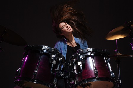 Photo for Female drummer playing the drums - Royalty Free Image