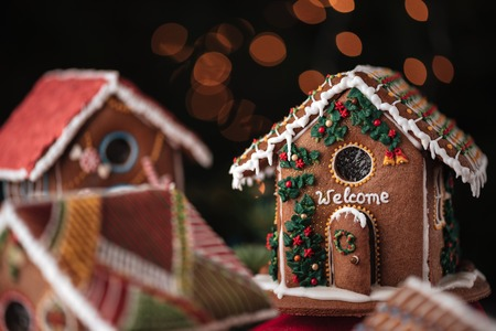 Photo for Sweet gingerbread houses decorated with inscription Welcome - Royalty Free Image