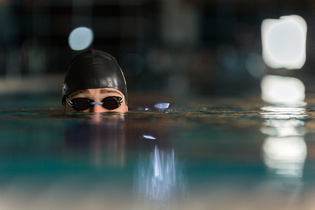 Photo for Close up of the top half of a male swimmers head submerged in a swimming pool - Royalty Free Image