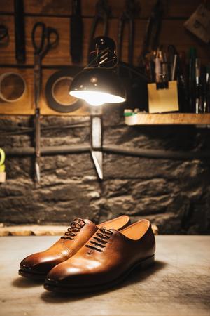 Photo pour Image of shoes on table at footwear workshop. - image libre de droit