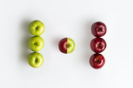 Foto de Top view of genetically modified red and green apples isolated over white - Imagen libre de derechos