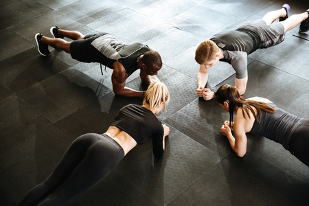 Photo pour Image of fitness group of people make sports exercise indoors. - image libre de droit