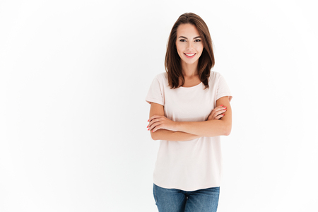 Photo for Smiling beauty woman with crossed arms looking at the camera over white background - Royalty Free Image