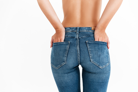 Photo pour Image of sexy ass in jeans of woman over white background - image libre de droit