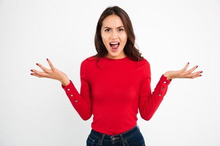 Foto für Portrait of an angry confused asian woman screaming and looking at camera isolated over white background - Lizenzfreies Bild