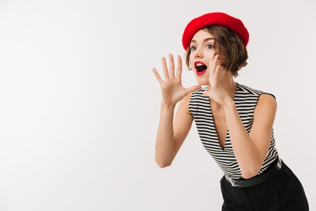 Photo pour Portrait of an excited woman wearing red beret screaming loud isolated over white background - image libre de droit