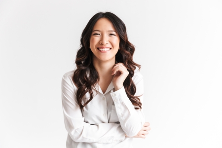 Photo for Portrait of gorgeous asian woman with long dark hair laughing at camera with beautiful smile isolated over white background in studio - Royalty Free Image