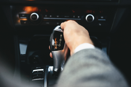 Photo for Business man driver hand shifting the gear stick - Royalty Free Image