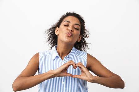 Photo pour Beautiful young african woman standing over white background, showing love gesture - image libre de droit