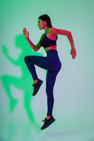 Photo for Image of amazing young strong fitness woman running isolated with led flash lights. - Royalty Free Image