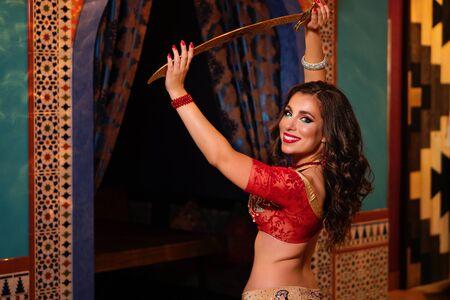Foto de Emotional portrait gorgeous woman belly dancer dancing in traditional belly dance costume. Ethnic dance. Belly dancing. Tribal dancing. - Imagen libre de derechos