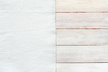 Foto de White velvet material and grunge wood board texture background. Surface of aged white wooden planks and striped texture fabric top view. - Imagen libre de derechos
