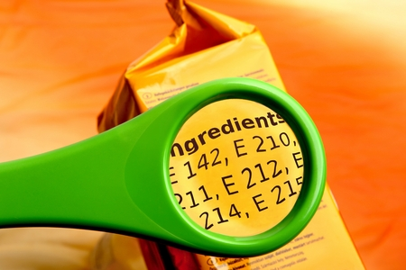 Photo for Concept of reading ingredients with magnifying glass. Magnifying glass on food additives label. - Royalty Free Image