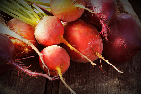 Photo for Fresh farm colorful beetroot on a wooden background. Detox and health. Selective focus. Red, golden, white beet - Royalty Free Image