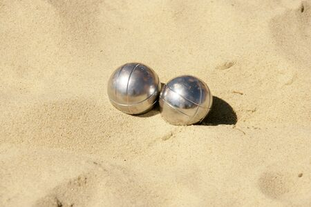 Photo for Metal balls in the sand - Royalty Free Image