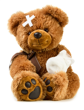 Foto de Teddy bear with bandage isolated on white background - Imagen libre de derechos