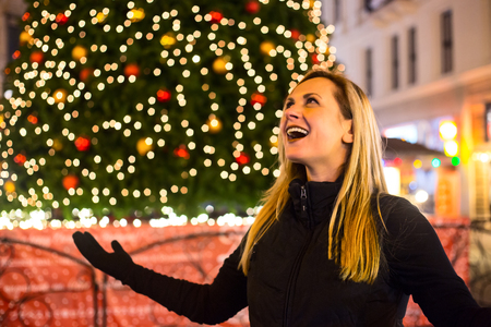 Photo for Portrait of young beautiful woman on Christmas tree night light background - Royalty Free Image