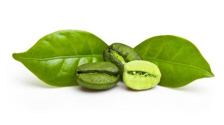 Foto de Green coffee beans with leaf isolated on white background. - Imagen libre de derechos