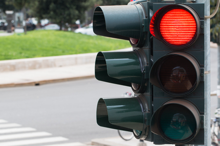 Photo pour In the photo you see a city traffic light, a red light is on. - image libre de droit