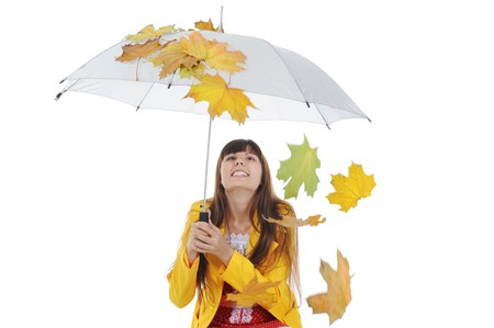 beautiful smiling girl in  in a yellow raincoat.  Isolated on white background