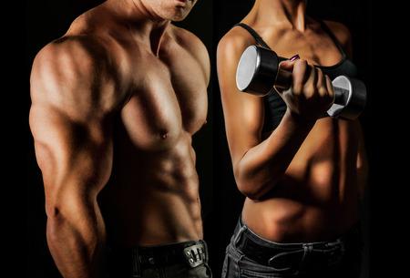 Photo pour Bodybuilding  Strong man and a woman posing on a black background - image libre de droit