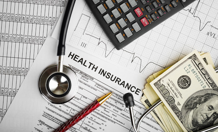 Foto de Health care costs. Stethoscope and calculator symbol for health care costs or medical insurance - Imagen libre de derechos