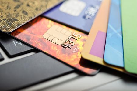 Photo pour E-commerce concept. group of credit cards and laptop with shallow DOF - image libre de droit