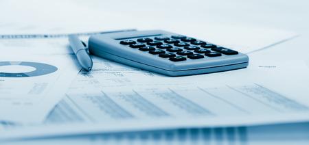 Photo pour Financial accounting.  Blue toned - image libre de droit