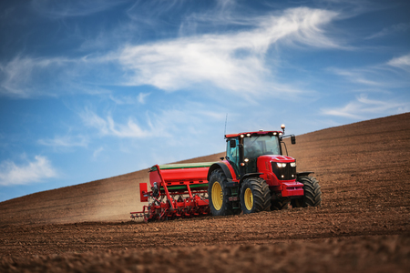 Photo for Farmer in tractor preparing farmland with seedbed for the next year - Royalty Free Image