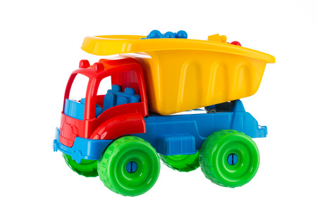 Foto de Colorful toy truck isolated on white background - Imagen libre de derechos